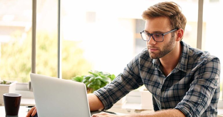 Online MBA student reading